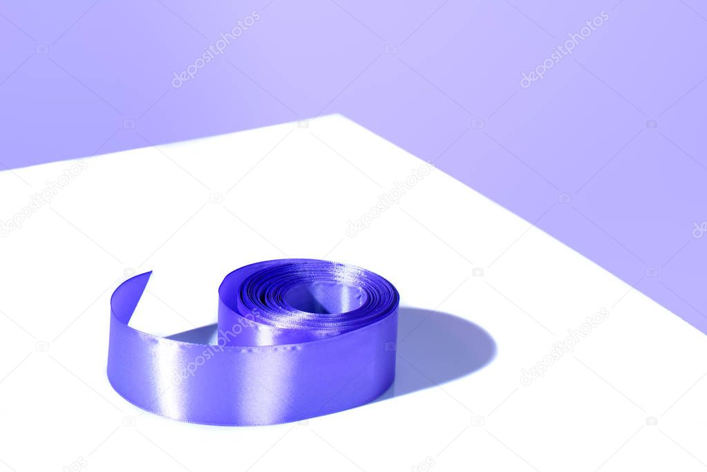decorative ultra violet ribbon, on white surface