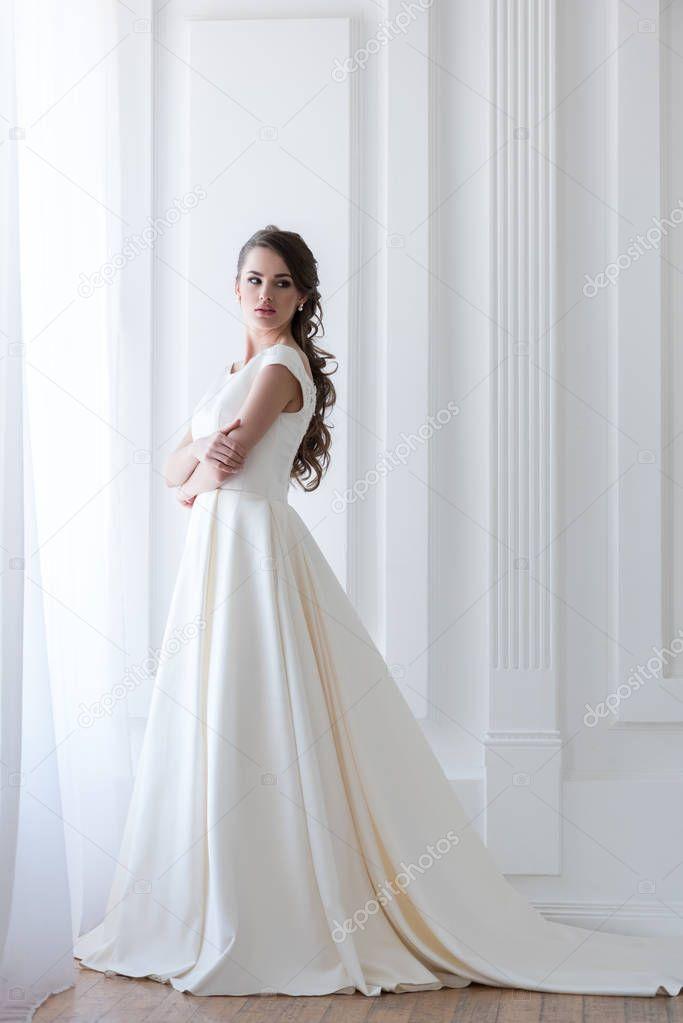 beautiful elegant bride in white wedding dress