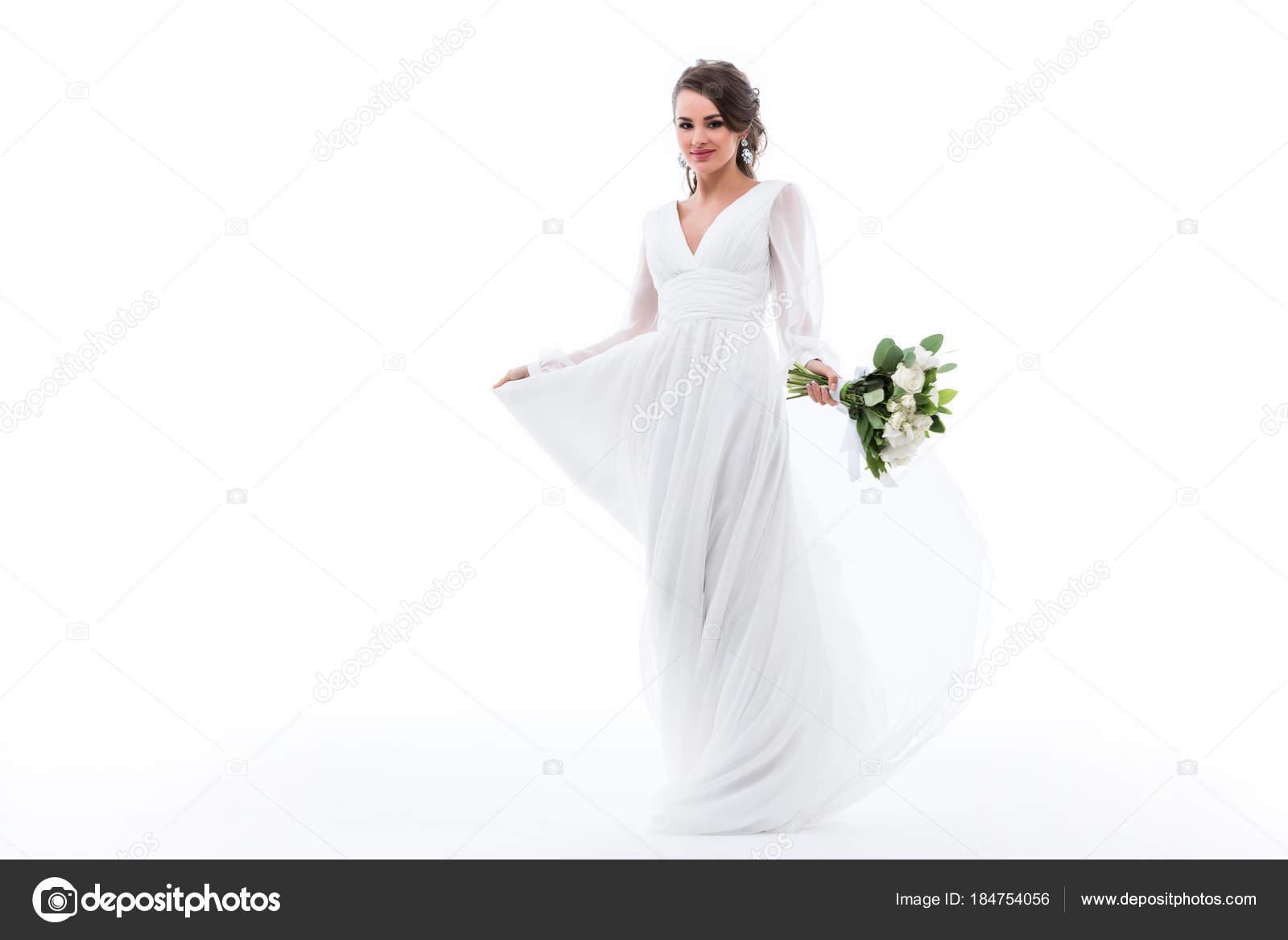 Witte Jurk Op Een Bruiloft.Aantrekkelijke Bruid Poseren Witte Jurk Met Bruiloft Boeket