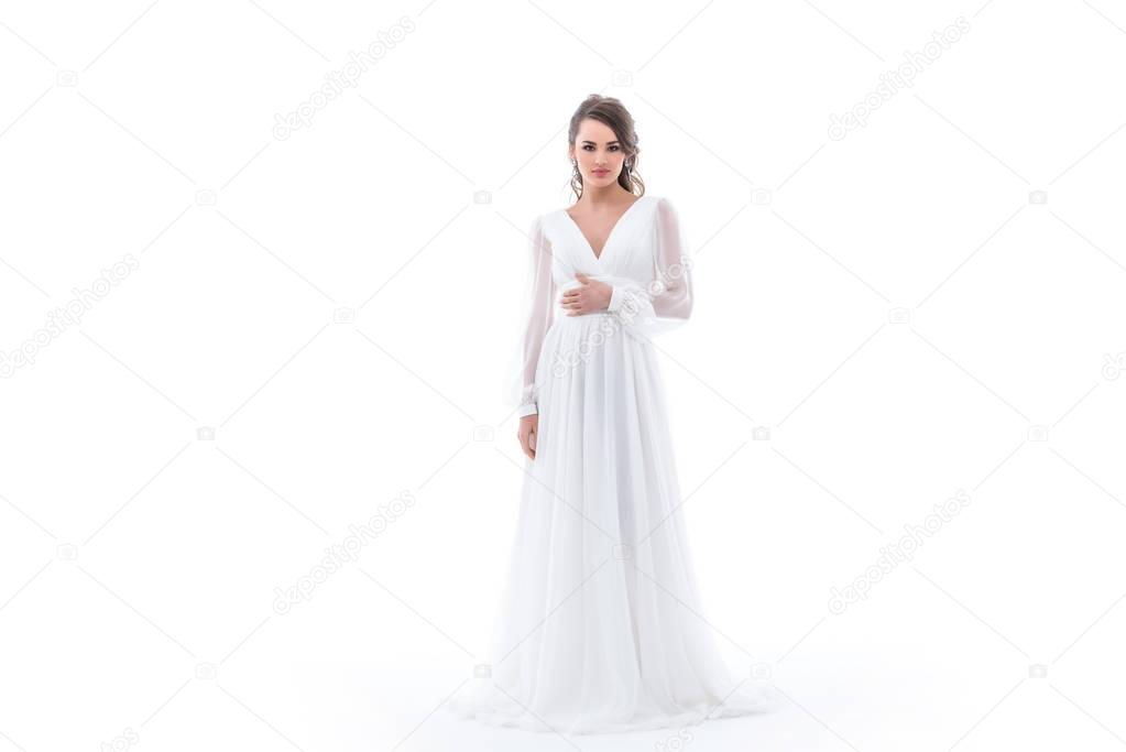 brunette bride posing in traditional wedding dress, isolated on white