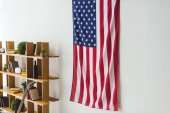 American flag hanging on wall inside living room