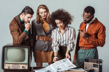 multicultural retro styled journalists in newsroom isolated on grey