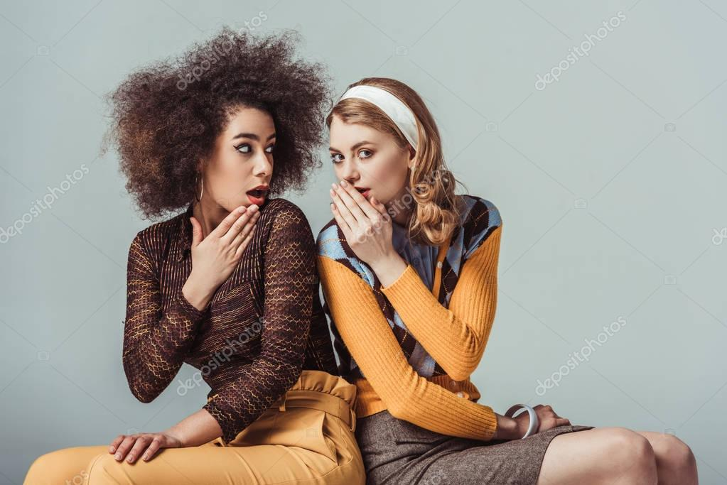 multicultural retro styled girls gossiping isolated on grey