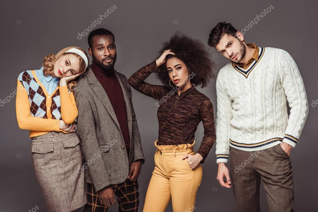 multicultural retro styled friends posing isolated on grey
