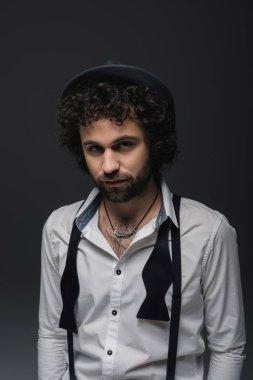 handsome bearded man in white shirt on black