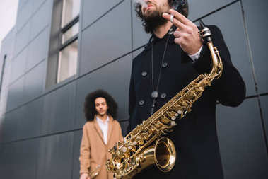 duet of street musicians standing outdoors