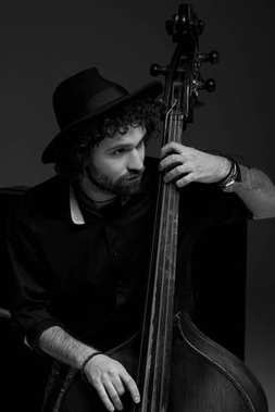 black and white shot of handsome musician playing standup bass