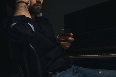 musician with glass of whiskey