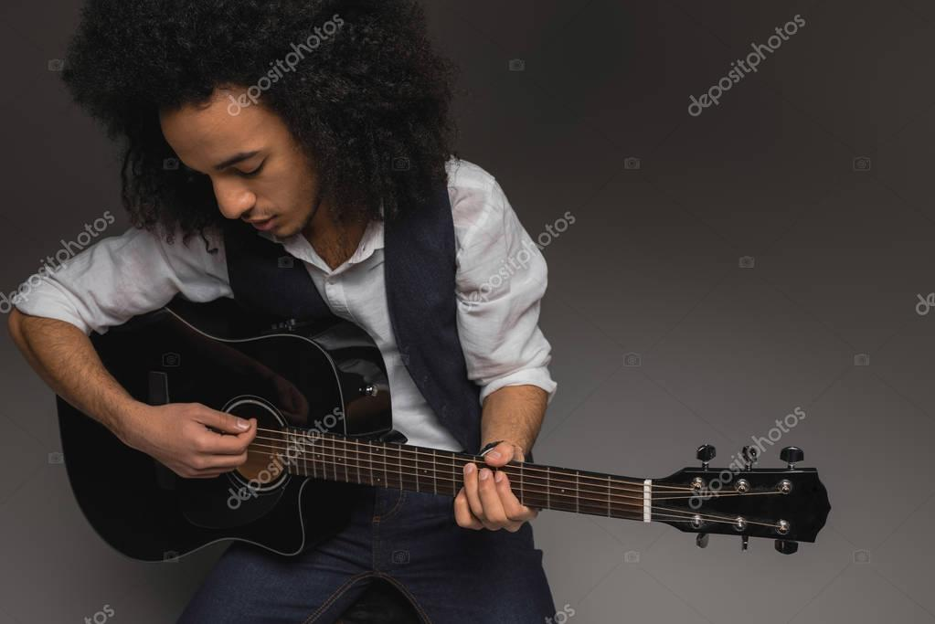 high angle view of musician playing acoustic guitar