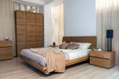 Photo Interior of cozy modern bedroom with closet and bed