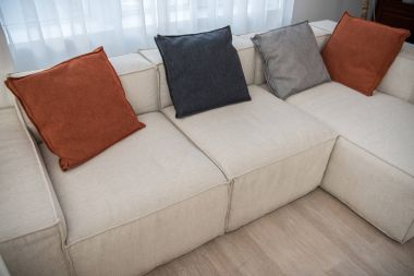High angle view of couch with multicolor pillows