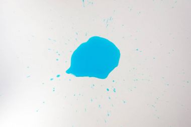 Close up view of blue blot of reagent isolated on white tabletop stock vector