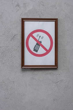 Restricted phone placard on concrete wall stock vector
