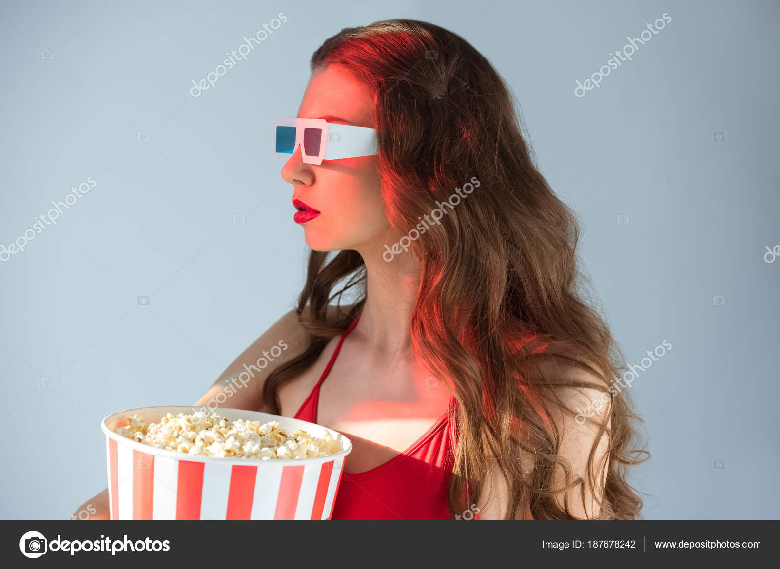 side view seductive girl glasses holding popcorn isolated grey
