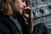 Fotografie close-up shot of young man smoking cigarette