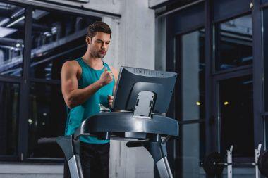 sportsman doing cardio training on treadmill in gym