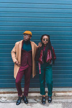 full length view of stylish young african american couple posing together on street