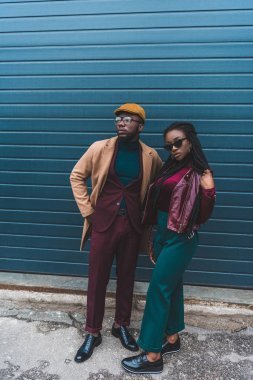 full length view of fashionable african american couple posing together on street