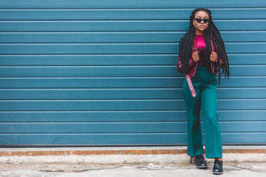 full length view of beautiful stylish young african american woman looking at camera