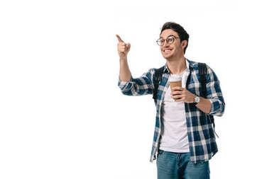 happy student holding coffee in paper cup and pointing on something isolated on white