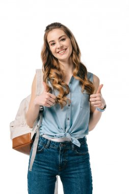 smiling beautiful student showing thumbs up isolated on white