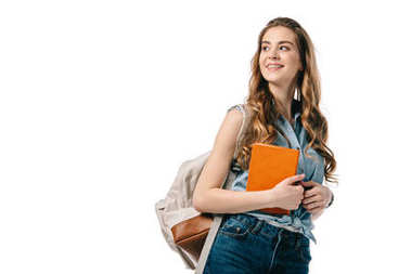 beautiful student holding book and looking away isolated on white