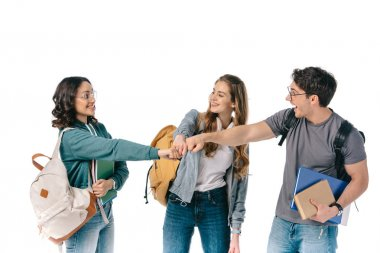 happy multicultural students making fist bump isolated on white