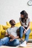 young african american couple spending time together at living room