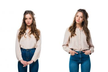 twins in trendy shirts and jeans looking at camera isolated on white