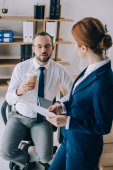 lawyers discussing work together at workplace in office