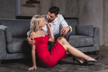 seductive beautiful young couple looking at each other in foreplay