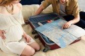 pregnant looking at map