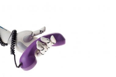 robot hand holding violet stationary telephone handset isolated on white