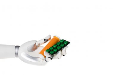 robot hand holding bottle and blister with pills isolated on white