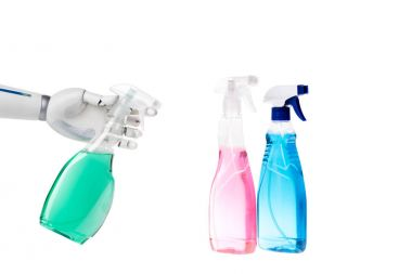 robot cleaning with spray bottle isolated on white