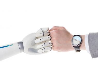 cropped shot of robot and businessman doing bro fist gesture isolated on white