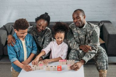 Army soldiers with happy kids playing words game