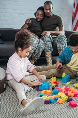 Army soldiers with happy kids playing with constructor