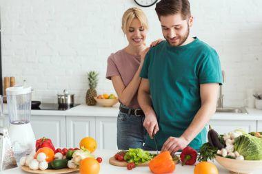 vegan boyfriend cutting vegetables at kitchen