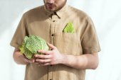 Fotografie partial view of man with fresh savoy cabbage in hands, vegan lifestyle concept