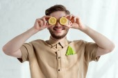 Fotografie obscured view of smiling man with lemon pieces and savoy cabbage leaf in pocket, vegan lifestyle concept