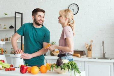 boyfriend preparing fresh juice at kitchen, vegan concept