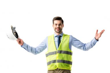 Smiling man in reflective vest holding hardhat isolated on white