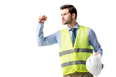 Confident construction worker in reflective vest isolated on white