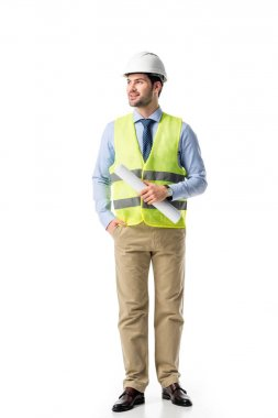 Smiling builder in reflective vest holding blueprint isolated on white