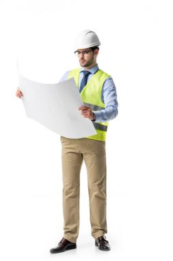 Thoughtful builder in reflective vest and helmet looking at blueprint isolated on white stock vector
