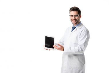 Smiling doctor wearing white coat presenting digital tablet isolated on white