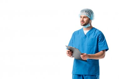 Surgeon wearing blue uniform and writing diagnosis in clipboard isolated on white