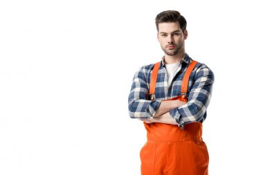workman in orange overall standing with folded arms isolated on white