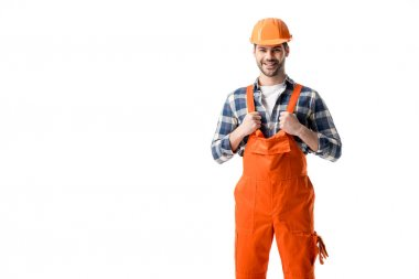 Smiling repairman in orange overall and hard hat isolated on white